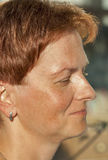 Smiling middle age woman face stock photo