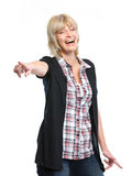 Smiling middle age woman pointing on you Stock Photography