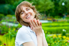 Smiling middle age woman portrait Stock Photography