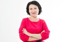 Smiling Middle age woman in red dress and crossed arms isolated on white background. Make up and beauty concept. Copy space stock photos