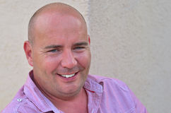 Smiling middle aged bald man. Happy smiling handsome middle aged bald man Stock Photo