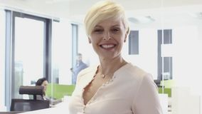 Smiling middle aged business woman in office