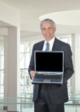 Smiling Middle aged Businessman with Computer stock photography