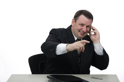 Smiling middle-aged businessman at the desc Royalty Free Stock Photos