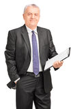 Smiling middle aged businessman holding clipboard Royalty Free Stock Images
