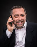 Businessman speaks on a mobile phone Royalty Free Stock Photography
