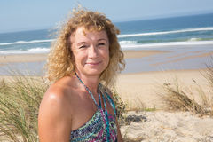Smiling middle aged caucasian attractive woman near the ocean Royalty Free Stock Image