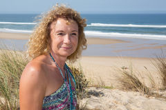 Smiling middle aged caucasian attractive woman near the ocean Royalty Free Stock Photography