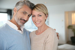 Smiling middle-aged couple at home Stock Photo