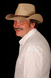 Smiling middle aged cowboy Royalty Free Stock Photography