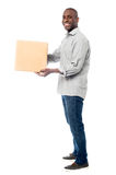 Smiling middle aged delivery man Stock Photo