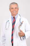Smiling Middle aged Doctor in Lab Coat Stock Photography