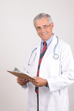 Smiling Middle aged Doctor in Lab Coat Royalty Free Stock Photography