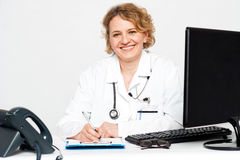 Smiling middle aged female doctor Royalty Free Stock Images