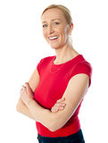 Smiling middle aged lady, poisng with folded arms Stock Photo