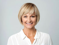 Smiling middle aged lady, studio shot. stock photo