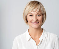 Smiling middle aged lady, studio shot stock photography
