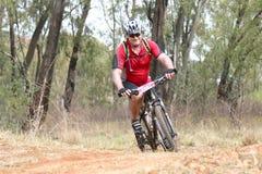Smiling middle aged man enjoying outdoors ride at Mountain Bike Royalty Free Stock Photo