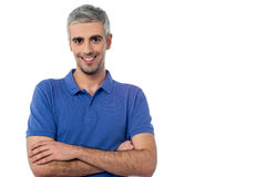 Smiling middle aged man isolated on white. Casually dressed middle aged man with arms folded Stock Images
