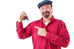 Smiling middle aged man pointing at car keys Royalty Free Stock Image