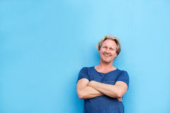 Smiling middle aged man posing with arms crossed Royalty Free Stock Photography