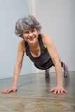 Smiling Middle Aged Sports Trainer in Pushup Position Royalty Free Stock Photo
