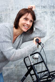 Smiling middle aged woman with bike Royalty Free Stock Image