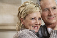 Smiling Middle Aged Woman Embracing Man Stock Images