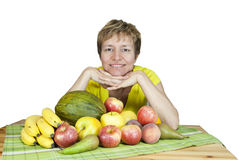 A  smiling middle-aged woman with a fruits. Stock Photography