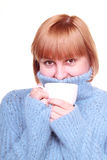 Smiling middle aged woman having coffee Royalty Free Stock Photography