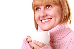 Smiling middle aged woman having coffee Stock Image