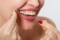 Smiling middle aged woman with ideal strong white teeth, teethcare. Selective focus. Healthcare, stomatological concept for dentis. Ts. Cleaning teeth stock image