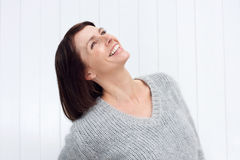 Smiling middle aged woman looking up Stock Image