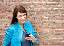 Smiling middle aged woman with mobile phone Stock Photography