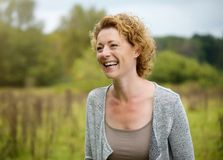 Smiling middle aged woman outdoors Stock Photography