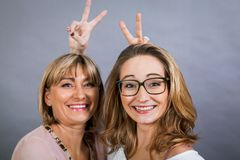 Smiling middle-aged young mother and daughter Stock Photo