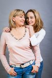 Smiling middle-aged young mother and daughter Stock Photography