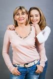 Smiling middle-aged young mother and daughter Royalty Free Stock Images
