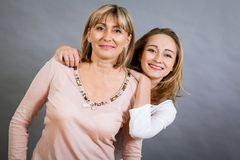 Smiling middle-aged young mother and daughter Stock Image
