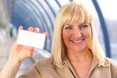 Smiling middleaged businesswoman show card Royalty Free Stock Photo