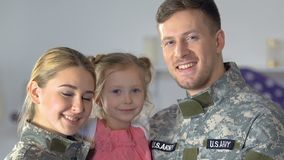 Smiling military couple and daughter looking camera, national pride, patriotism. Stock footage stock footage