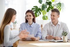 Confident female applicant talk making good first impression on. Smiling millennial HR managers listen to female job applicant talking at interview, confident stock images
