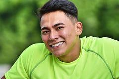 Smiling Minority Male Athlete. A handsome adult hispanic man Stock Image