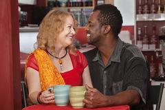 Smiling Mixed Couple in Cafe Royalty Free Stock Photography
