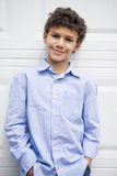 Smiling mixed race boy with hands in pockets Stock Photos