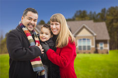 Smiling Mixed Race Family in Front of House Stock Images