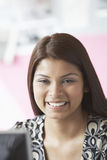 Smiling Mixed Race Female Executive At Office Royalty Free Stock Photography