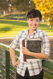 Smiling Mixed Race Female Student Holding Books Stock Photos