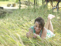 Smiling Mixed Race Woman Lying In Meadow Royalty Free Stock Image