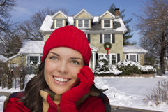 Smiling Mixed Race Woman in Winter Clothing Outside in Snow Royalty Free Stock Images